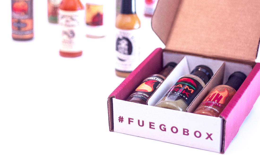 Fuego Box - Branded box with 3 slots containing bottles of hot sauce