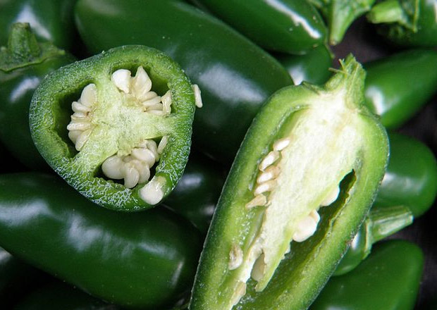 Green jalapeno hot peppers. Freshly picked, and sliced.